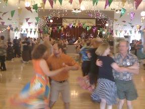 Contra Carnivale dancers swinging